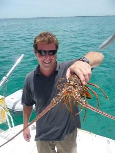 captain cliff holds lobster caught for dinner in belize