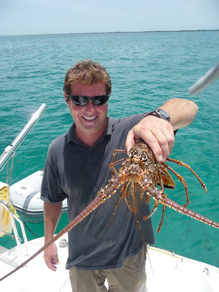 captain cliff holds lobster caught for dinner in belize