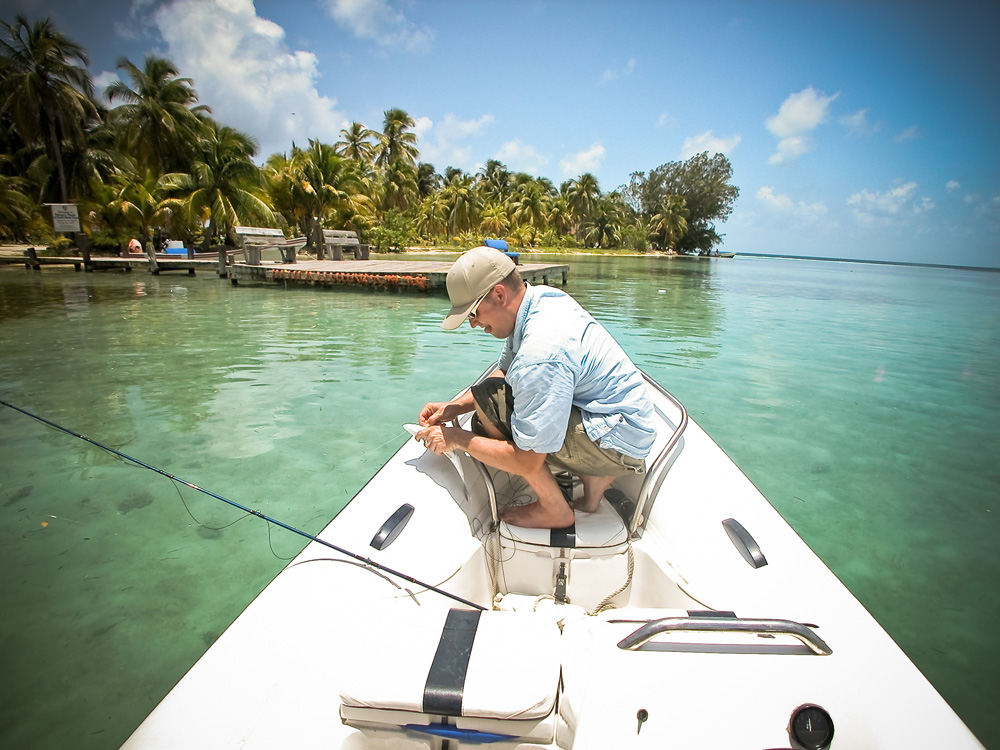 catching bonefish in belize while on charter with belize sailing vacations