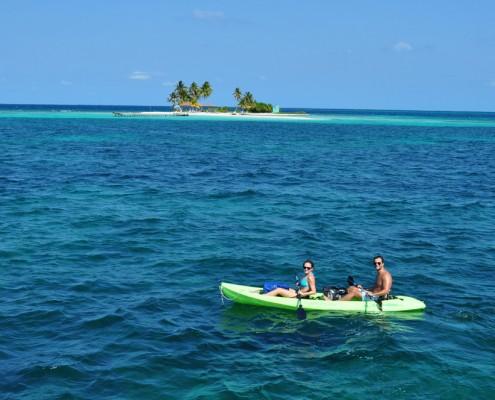 couple sea kayak belize goff's caye island exploration