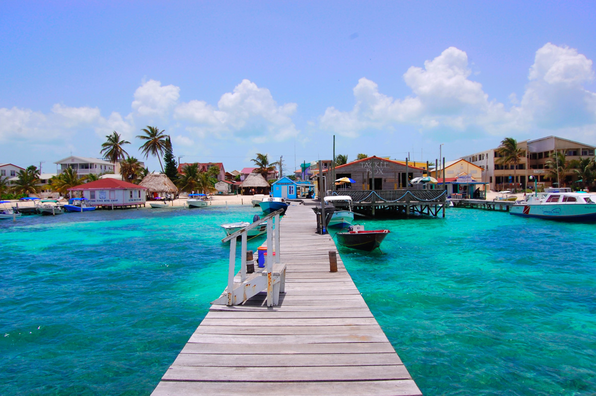 dock near tackle box in blue green waters on ambergris caye belize