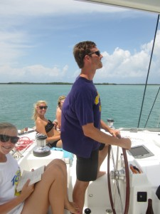 family on catamaran sailing adventure in the islands of belize