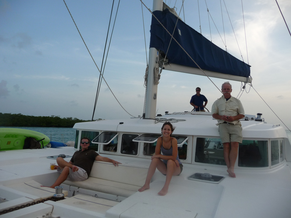 Guests on relax on luxury catamaran on vacation in Belize