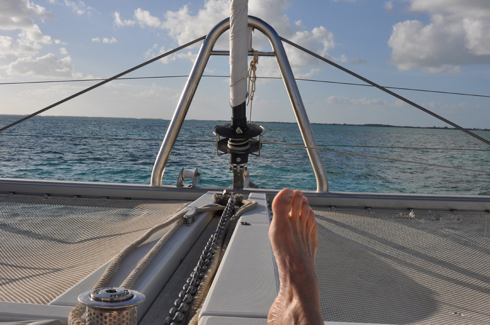 relaxing in sun on catamaran enjoying epic vacation in belize