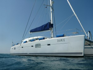 snorkeling next to luxury yacht and catamaran Doris on charter