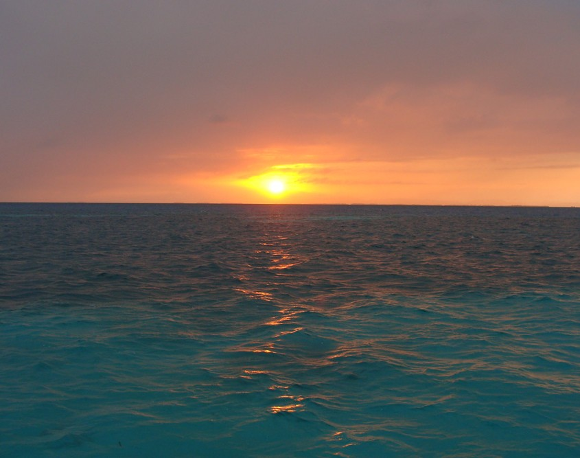 sunset belize blue water ocean reef waves