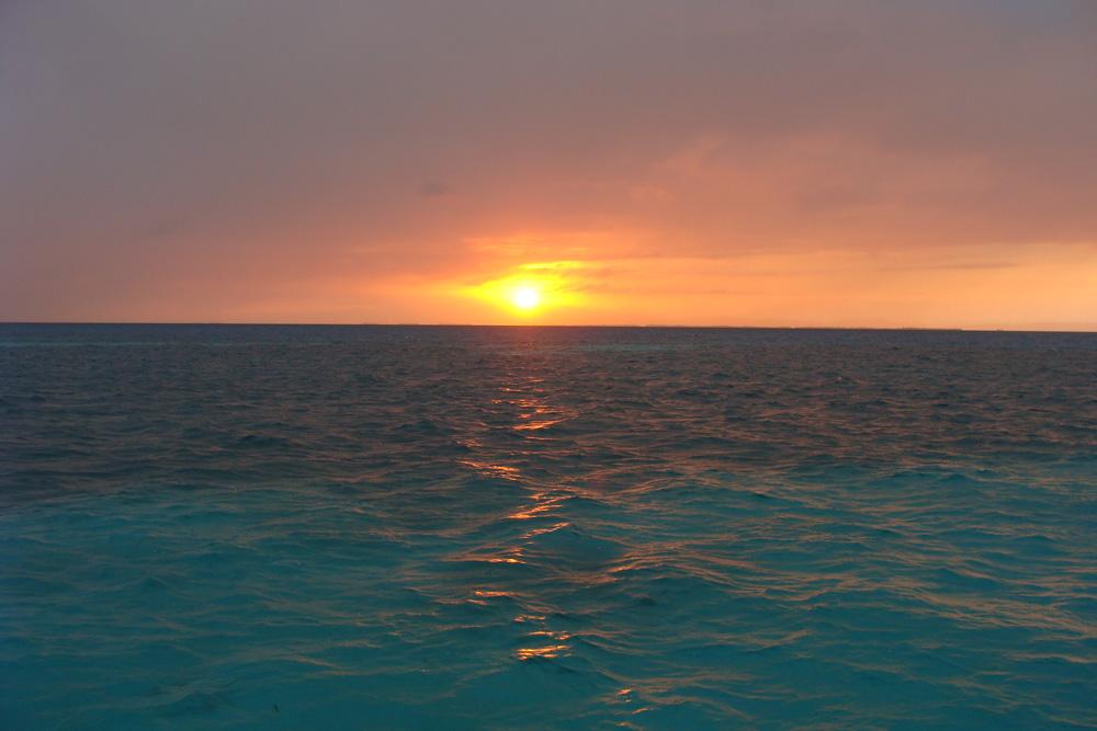 sunset belize blue water ocean reef waves