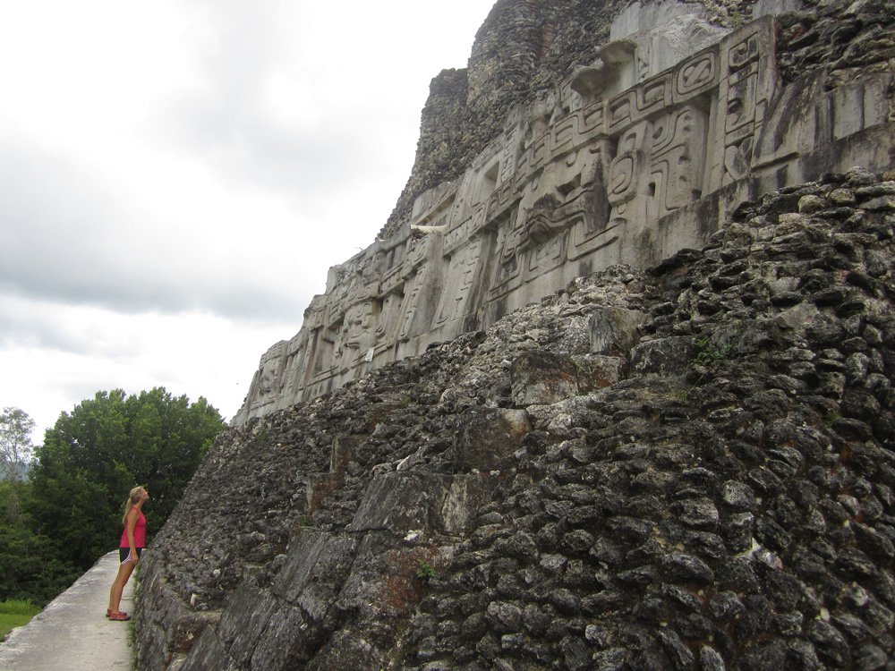 woman explores mayan temple in belize